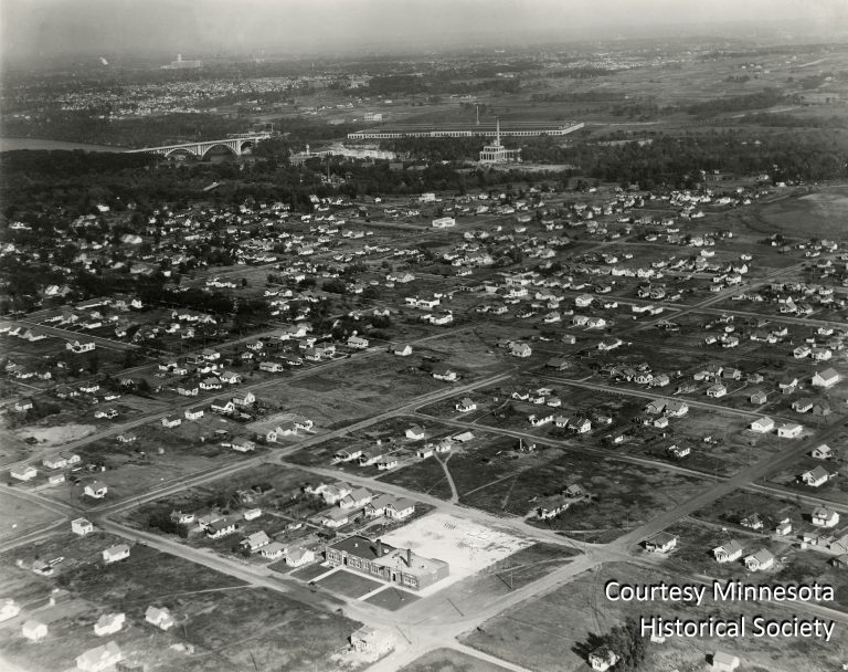 This aerial photo, taken around 1928, shows the different pace at which the two cities were developing along the river. The Minnehaha neighborhood (foreground) showed substantial activity, while the area to the east of the new Ford plant remained largely vacant. Courtesy Minnesota Historical Society
