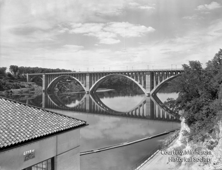 The Intercity Bridge, better known as the Ford Bridge, was completed in 1927, connecting the growing Longfellow neighborhood of Minneapolis to the area around the new Ford plant. Courtesy Minnesota Historical Society