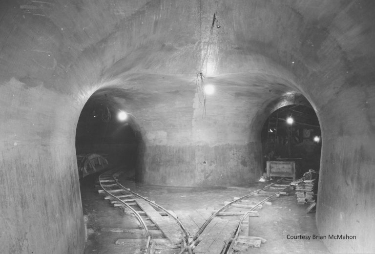 Tunnels were constructed approximately 100 feet below the surface to facilitate the mining of silica sand for the glass plant. Other tunnels were built for the steam pipes that connected the steam plant to the assembly plant, and for the electrical cables connecting the hydroelectric plant to the main plant. Traffic tunnels enabled finished vehicles to be transported out to the wharf. Courtesy Brian McMahon